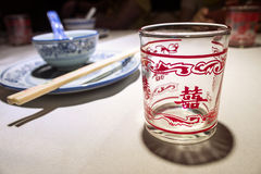 Tablewares and glass cup with a Chinese character Royalty Free Stock Photography
