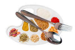 Tablewares and a palette of spices Stock Photos
