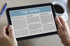 Tablilla de Digitaces que muestra noticias Imágenes de archivo libres de regalías
