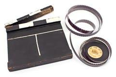 Tablilla de la película del vintage y rollo de película de 16 milímetros Foto de archivo libre de regalías