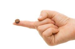 Tablilla en un dedo de una mano femenina Fotos de archivo libres de regalías