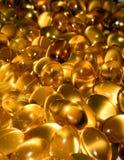 Tablillas del petróleo de hígado de bacalao Imagenes de archivo