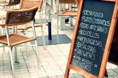 Tabloid with menu in a terrace. Tabloid offering fast food in an empty terrace in San Sebastian, Spain. Vintage effect edition Stock Photo