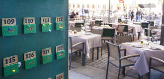 Tabloid for tables orders at terrace restaurant. Green tabloid for tables orders at terrace restaurant, Spain Stock Photo