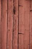 Tablones agrietados de la peladura de madera roja Fotos de archivo libres de regalías