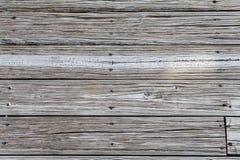 Tablones gastados de la playa con Rusty Nails Imagenes de archivo