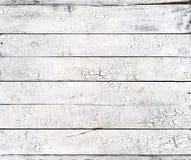 Tablones resistidos lamentables viejos de madera blancos con textura rústica de la pintura agrietada imagen de archivo