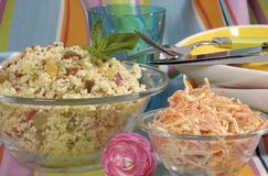 Tabolui salad. A healthy tabouli salad in clear dishes, ready for a meal royalty free stock images