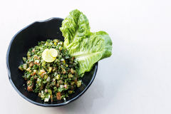 Tabouleh traditional lebanese middle eastern salad bowl meze sta. Tabouleh traditional lebanese middle eastern fresh salad bowl meze mezze starter Royalty Free Stock Images