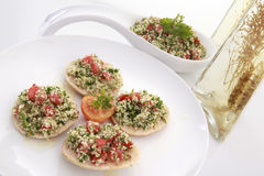 Tabouli on pita bread with spiced olive oil Stock Images