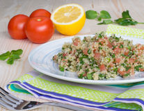 Tabouli with quinoa, tomatoes and herbs Royalty Free Stock Image
