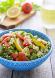 Tabouli salad in blue bowl Stock Images