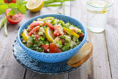 Tabouli salad in blue bowl Royalty Free Stock Image