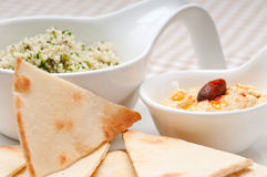 Taboulii couscous with hummus Royalty Free Stock Photos