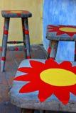 Tabourets avec la peinture du soleil Images libres de droits