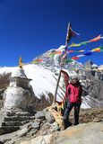 Tabuche trekker with buddhism flag from nepal in everest himalay Stock Photos