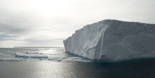 Tabular Iceberg Corner. The corner of a massive tabular iceberg, backlit by the sun - Antarctic Stock Photo