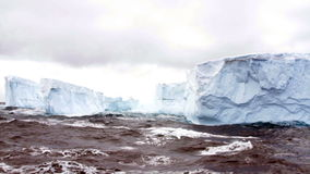 Tabular iceberg field, rough seas, Antarctica stock footage