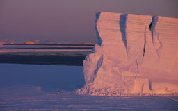 Tabular iceberg. Sunrise on iceberg at Snow Hill island, Weddell sea, Antartica Royalty Free Stock Images