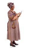 Tabuleta africana idosa da mulher imagem de stock royalty free