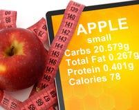 Tabuleta com calorias em Apple e na fita de medição Imagem de Stock