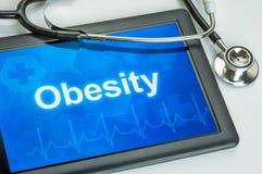 Tabuleta com a obesidade do diagnóstico Fotografia de Stock