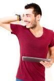 Tabuleta de utilização masculina nova imagem de stock royalty free