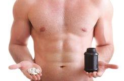 A tabuleta do arrasto dos comprimidos encaixota o homem dos suplementos isolado Fotografia de Stock Royalty Free