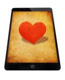 Tabuleta preta com coração vermelho Imagens de Stock Royalty Free