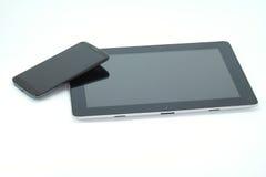 Tabuleta preta e telefone esperto Foto de Stock