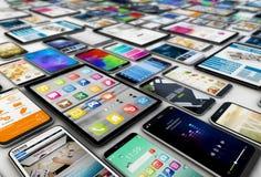 Tabuletas e smartphones Foto de Stock