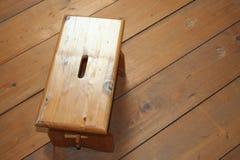 Taburete de madera en el fondo de madera Fotografía de archivo libre de regalías