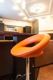 Taburetes anaranjados y de cuero Fotos de archivo libres de regalías