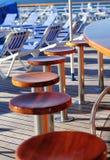 Taburetes de barra en cubierta del barco de cruceros Imágenes de archivo libres de regalías