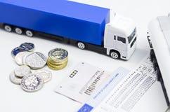 Tacógrafo y dinero del camión Imagen de archivo