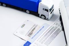 Tacógrafo y dinero del camión Imágenes de archivo libres de regalías
