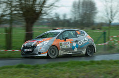 TAC Rally 2015 Belgium. A Peugeot 307 from GPC Rallyteam during a stage of the TAC Rally. Panned photograph to capture the speed of the car Royalty Free Stock Image