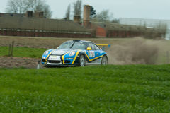 TAC Rally 2015 Belgium. A Porsche GT3 from Tabaknatie Rallyteam with VanParijs - Heyndrickx during a stage of the TAC Rally. Panned photograph to capture the Royalty Free Stock Photos