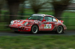 TAC Rally 2015 Belgium. A Porsche 911 during a stage of the TAC Rally. Panned photograph to capture the speed of the car Stock Photo