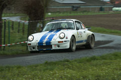 TAC Rally 2015 Belgium. A Porsche 911 during a stage of the TAC Rally. Panned photograph to capture the speed of the car Stock Photography