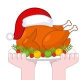 Tacchino di Natale in cappuccio di Santa Claus Gallinacei dell'arrosto sul piatto con la VE royalty illustrazione gratis