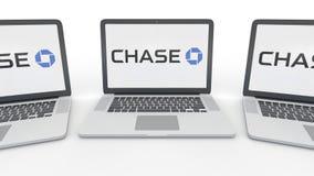 Taccuini con il logo di JPMorgan Chase Bank sullo schermo Rappresentazione concettuale dell'editoriale 3D di tecnologie informati Immagini Stock Libere da Diritti