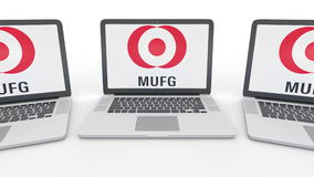 Taccuini con il logo di MUFG sullo schermo Rappresentazione concettuale dell'editoriale 3D di tecnologie informatiche Immagine Stock Libera da Diritti