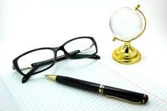 Taccuini, penne, vetri Fotografia Stock