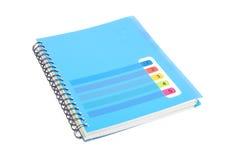 Taccuino blu isolato su bianco Fotografie Stock