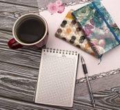 Taccuino con caffè Fotografie Stock