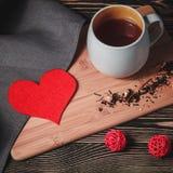 Taccuino con carta in forma di cuore rossa Fotografie Stock