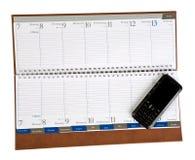 Taccuino con il telefono mobile isolato Fotografia Stock