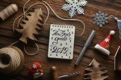 Taccuino con la decorazione nel tema del nuovo anno fotografia stock libera da diritti