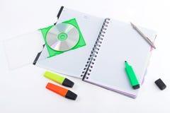 Taccuino con la penna ed il disco Fotografie Stock Libere da Diritti